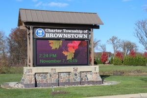 the sign for the charter township of brownstown in the fall