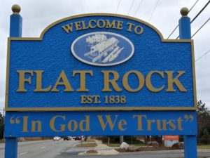 welcome to the city of flat rock sign