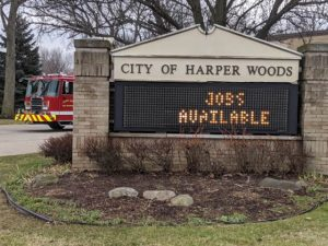 the city of harper woods sign